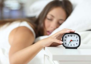woman-sleep-alarm-clock-time-change